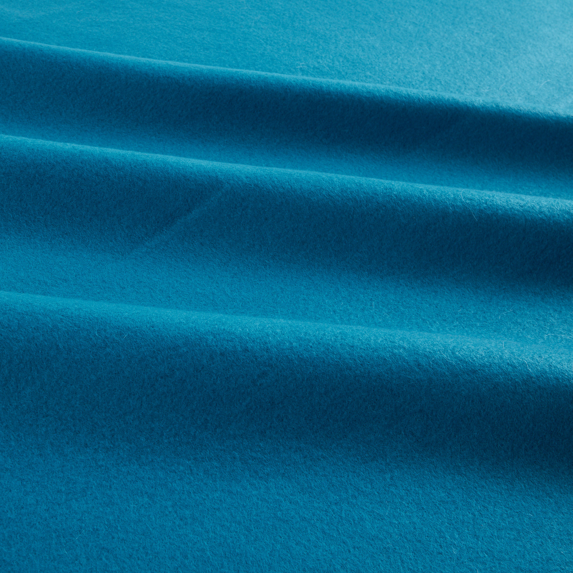 Polar Fleece Solid Turquoise Fabric by Newcastle in USA